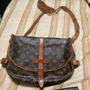 Louis Vuitton Saumur bag and wallet